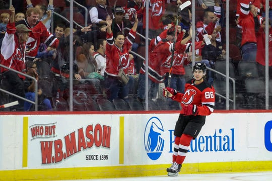 New Jersey Devils center Jack Hughes celebrates after scoring a goal during the first period of the team's preseason  game against the New York Rangers, Friday, Sept. 20, 2019, in Newark, N.J.