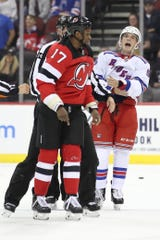 New York Rangers defenseman Ryan Lindgren (55) yells at New Jersey Devils right wing Wayne Simmonds as they leave the ice after fighting during the first period of a preseason game Friday, Sept. 20, 2019, in Newark, N.J.