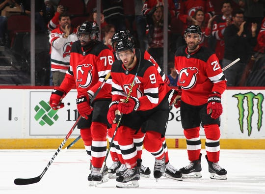 Taylor Hall #9 of the New Jersey Devils celebrates his power-play goal at 11:55 of the first period against the New York Rangers at the Prudential Center on September 20, 2019 in Newark, New Jersey.