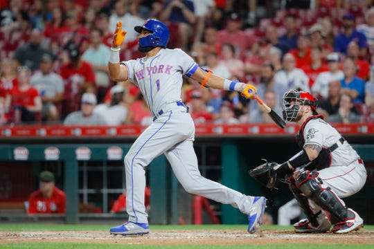 New York Mets' Amed Rosario hits a solo home run off Cincinnati Reds starting pitcher Luis Castillo in the seventh inning of a baseball game, Friday, Sept. 20, 2019, in Cincinnati.