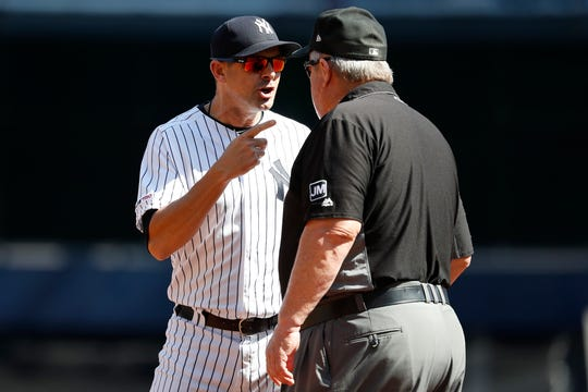 New York Yankees manager Aaron Boone argues with third base umpire Joe West after the first inning of the team's baseball game, Saturday, Sept. 21, 2019, in New York.