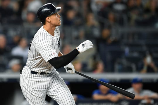 New York Yankees' Aaron Judge watches his home run during the fourth inning of the team's baseball game against the Toronto Blue Jays, Friday, Sept. 20, 2019, in New York.