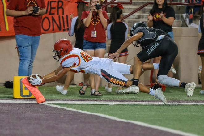 Mikah Gutierrez (82)runs for a touchdown after the Centennial Hawks face off against the Oñate Knights at Aggie Memorial Stadium in Las Cruces on Saturday, Sept. 20, 2019.