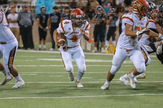 Sophomore quarterback Ian Lopez (4) runs the ball as the Centennial Hawks face off against the Oñate Knights at Aggie Memorial Stadium in Las Cruces on Saturday, Sept. 20, 2019.