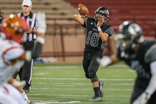 Junior Quarterback Mathew Saenz (18) throws the ball as the Centennial Hawks face off against the Oñate Knights at Aggie Memorial Stadium in Las Cruces on Saturday, Sept. 20, 2019.