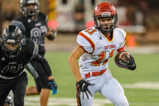 Junior wide receiver Isaac Gutierrez (11) receives and runs the ball as the Centennial Hawks face off against the Oñate Knights at Aggie Memorial Stadium in Las Cruces on Saturday, Sept. 20, 2019.