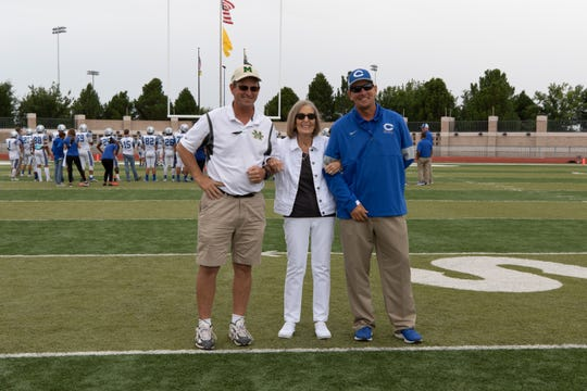 Mayfield coach Michael Bradley, along with Carlsbad coach Gary Bradley with their mother Phyllis Bradley. Mayfield High School faced Carlsbad High School on September 21, 2019.