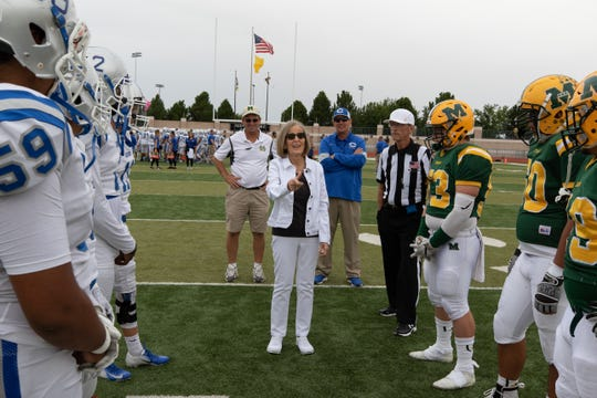 Phyllis Bradley flips the opening coin toss. Mayfield High School faced Carlsbad High School on September 21, 2019.