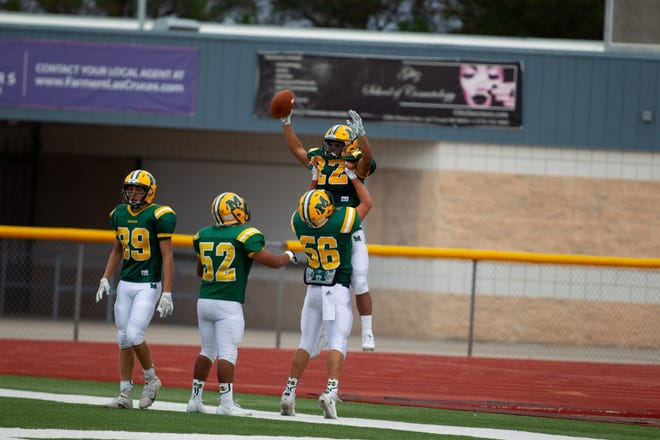Mayfield senior running back Matt Riley (22) celebrates a touchdown during the Trojans' 27-14 win over Carlsbad on Saturday, Sept. 21, at the Field of Dreams.