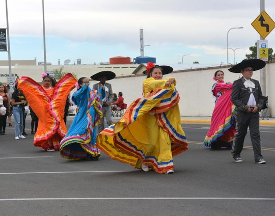 Dancers from La Academia Dolores Huerta perform along the La Gran Fiesta parade route in downtown Las Cruces on Saturday, Sept. 21, 2019.