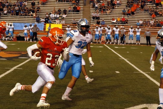 Artesia's Johntae Rodriguez runs for a first down after faking a punt against Cleveland in the first quarter on Sept. 20, 2019.