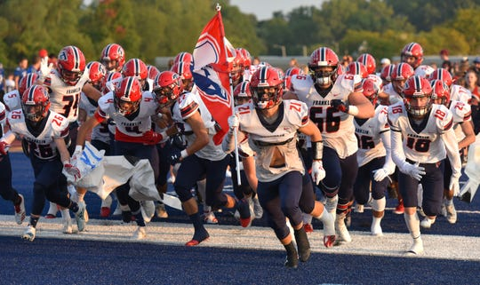 The Franklin Patriots run onto the field on Sept. 20.