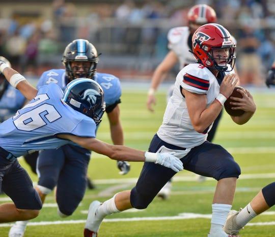 Livonia Franklin quarterback Jake Kelbert runs in his second touchdown of the game against Livonia Stevenson on September 20, 2019.