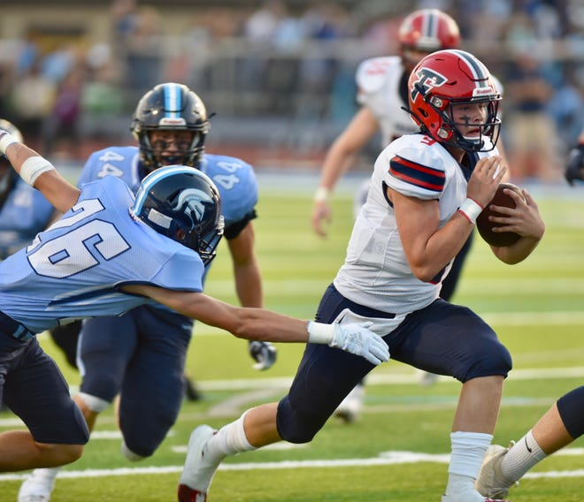 Livonia Franklin quarterback Jake Kelbert runs in his second touchdown of the game against Livonia Stevenson on September 20, 2019.