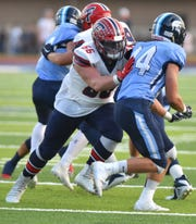 Franklin Patriot lineman Jake Swirple, left, blocks a Spartan during the teams' Sept. 20 game.
