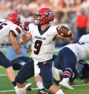 Franklin Patriot Jacob Kelbert drops back to pass during their Sept. 20 game at Stevenson.