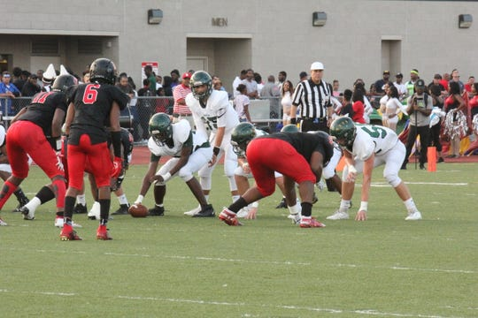 Groves quarterback Markis Alexander lines up at the line of scrimmage. Groves falls to Oak Park 26-14 on the road on Sept. 20.