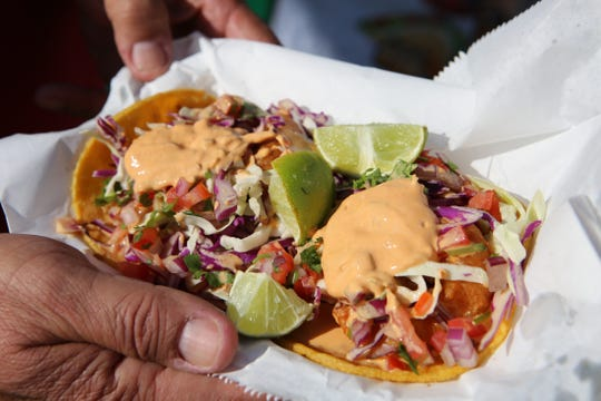 A shrimp taco from Taco Quintero is one of many vendors at El Grito Fiestas Patrias in Coachella, Calif., on Saturday, September 21, 2019.