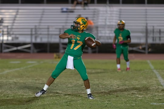 Coachella Valley quarterback  Jacob Calderon drops back for the pass against Yucca Valley on Sept. 20, 2019.