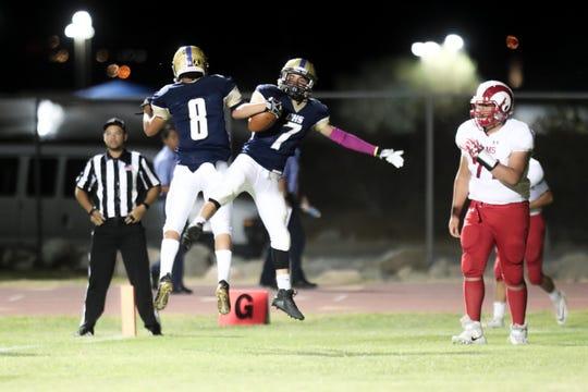 Desert Hot Springs' Enrique Florez and Adam Benavidez celebrate a touchdown in a game versus Desert Mirage on Friday, September 20, 2019 in Desert Hot Springs, Calif.