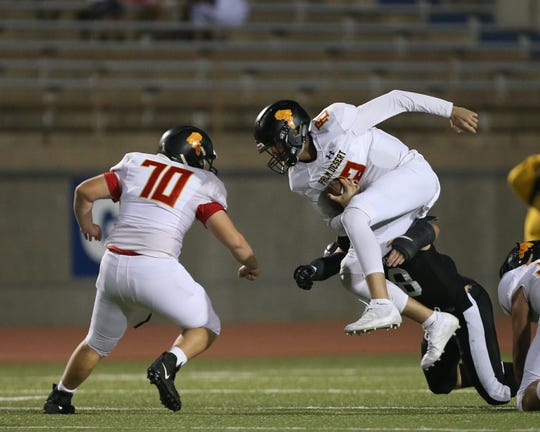 Palm Desert quarterback Garrett Hayden tried to elude a tackle Friday against Permian in Odessa, Texas.