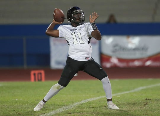 Oshea Wallace of Cathedral City passes against Indio during their game in Indio, Calif., September 20, 2019.