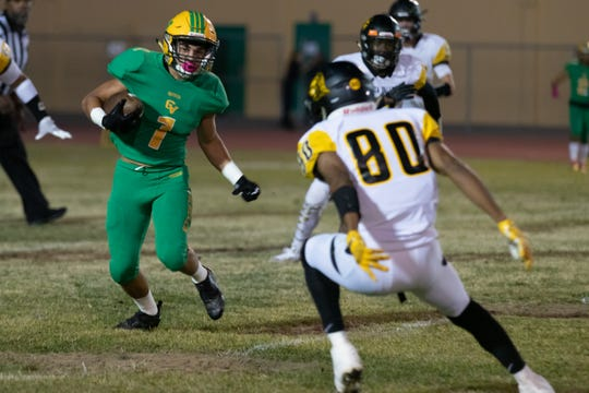 Jose Marquez (1) of Coachella Valley runs for yardage as Yucca Valley's Kristopher Brady tries to tackle him Sept. 20, 2019.