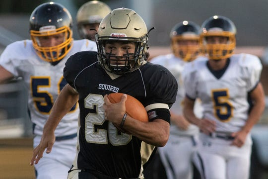 Delone Catholic's Joe Hernandez, center, breaks a long run. Delone Catholic plays Littlestown in football at Delone Catholic High School in McSherrystown, Friday, September 20, 2019.
