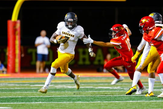 Kelee Ringo evades a tackler in the game against Chaparral High School in Scottsdale, AZ on Sept 20, 2019.