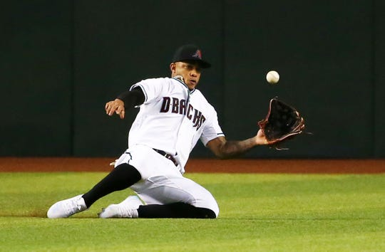 Arizona Diamondbacks center fielder Ketel Marte makes a sliding catch of a fly ball from Baltimore Orioles Chance Sisco in the first inning at Chase Field on July 23, 2019 in Phoenix, Ariz.