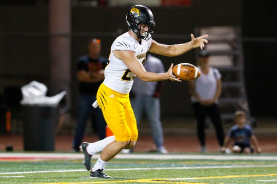 Saguaro High School punter Parker Lewis drops the ball to punt against the Chaparral Firebirds in Scottsdale, AZ on Sept 20, 2019.