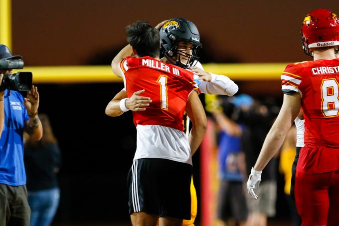 Saguaro High School quarterback Tyler Beverett and Chaparral Firebirds quarterback Jack Miller III hug prior to their matchup in Scottsdale, AZ on Sept 20, 2019.
