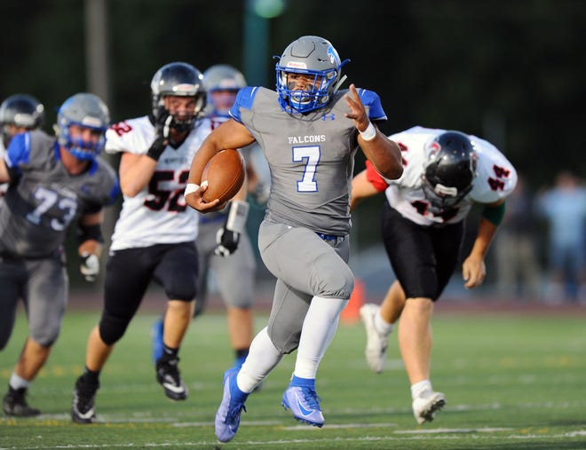Tyler Cruz (7) of Cedar Crest heads down field on a long touchdown run early in the first quarter of action.