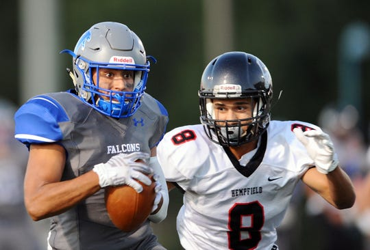 Cedar Crest's Chris Rios (3) pulls in a long pass over Hempfield's David Almodovar (8) early in the first quarter.
