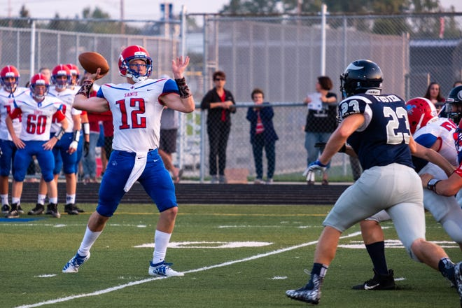St. Clair quarterback Brady Gleason (12) looks to throw a pass during their game against Marysville Friday, Sept. 20, 2019, at Marysville High School.