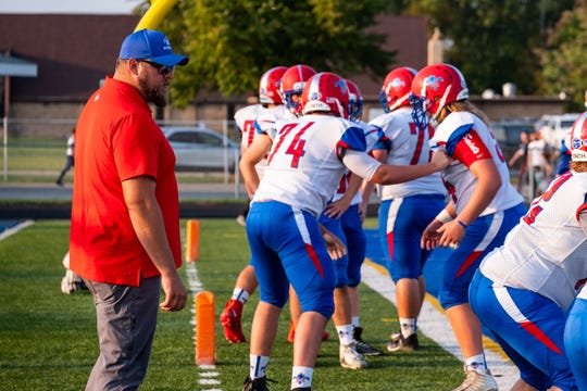 St. Clair assistant coach Tim Lelito watches the team run warmup drills before their game Friday, Sept. 20, 2019, at Marysville High School.