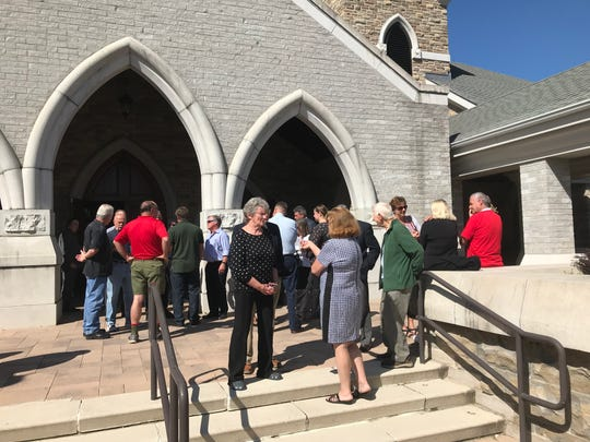 Mourners gather outside Saint Kateri Tekakwitha church in LaGrangeville following a memorial for Gerard Bocker of Union Vale, who was killed in August when a plane crashed into his house.