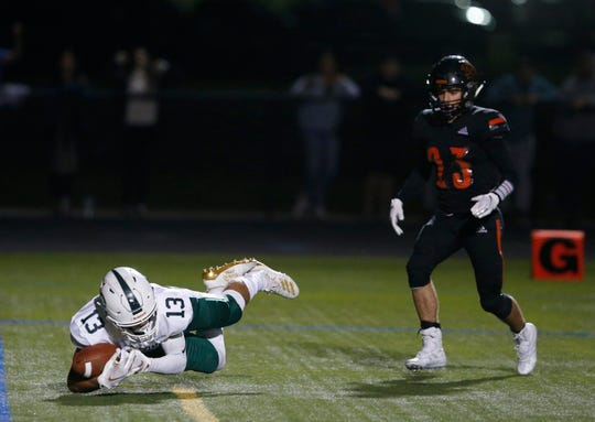 Cornwall's Louis Francese makes a diving catch to score a touchdown during Friday's game versus Marlboro on September 20, 2019.