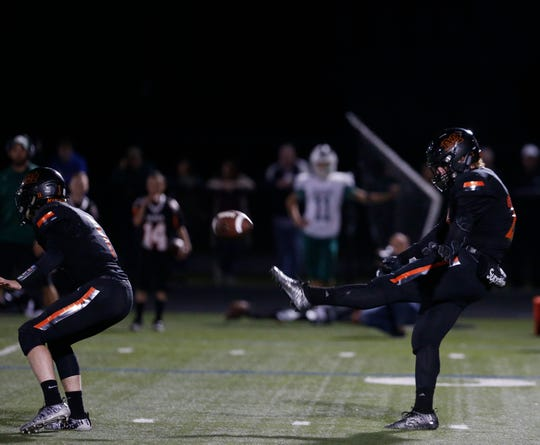 Marlboro's Freddie Callo gets off a punt against Cornwall during a Sept. 20 football game.