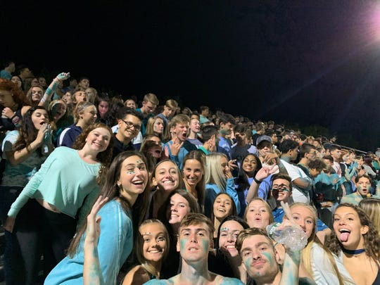 """Several John Jay-East Fishkill fans painted their faces and bodies in teal, or wore clothing for the team's """"Teal Out"""" game in support of ovarian cancer research."""