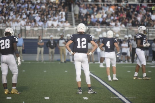 Chambersburg quarterback Brady Stumbaugh awaits a playcall on Friday, September 20 against State College at Trojan Stadium.
