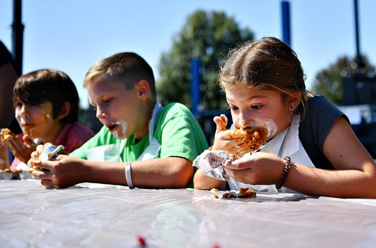 Bailie DeMaria, 8, of Hempfield in Lancaster County, wins third place in the children's vegan pumpkin pie eating contest during Harvest Vegfest at Cousler Park in Manchester Township, Saturday, Sept. 21, 2019. DeMaria was visiting her grandparents who live in Manchester Township. Dawn J. Sagert photo