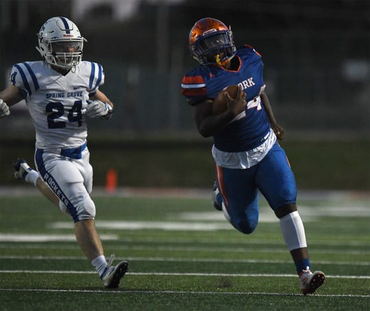 York High's Kelvin Matthews (24) is chased by Spring Grove's Darien Osmun (24) during a game at Smalls Athletic Field in York on Friday, Sept. 20, 2019.
