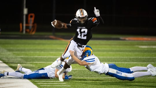 David Moye (12) breaks two tackles during the YAIAA football game between York Suburban and Kennard-Dale at York Suburban Senior High School, Friday, September 20, 2019. The Trojans defeated the Rams 35-13.