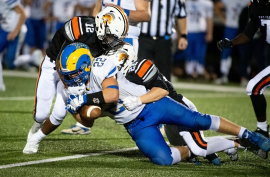 Wyatt McCleary (22) secures the first down during the YAIAA football game between York Suburban and Kennard-Dale at York Suburban Senior High School, Friday, September 20, 2019. The Trojans defeated the Rams 35-13.