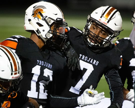 David Moye (12) and Jayce Henderson (7) discuss a recent play during the YAIAA football game between York Suburban and Kennard-Dale at York Suburban Senior High School, Friday, September 20, 2019. The Trojans defeated the Rams 35-13.