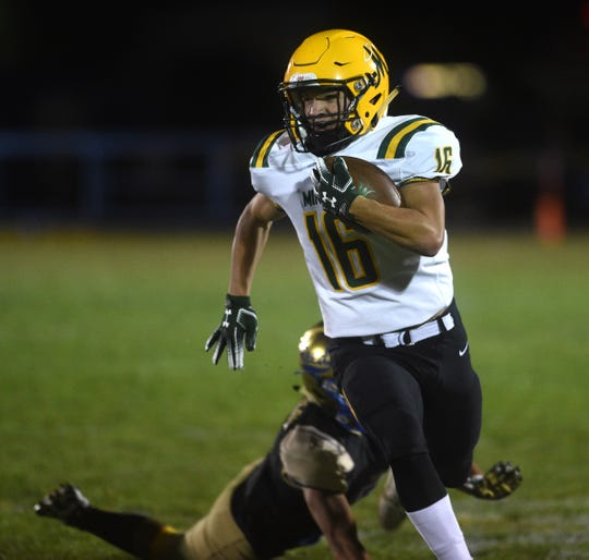 Bishop Manogue's Jordan Wilson (16) runs free while taking on Reed during their football game in Sparks on Sept. 20, 2019.