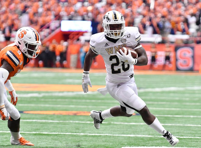 Sep 21, 2019; Syracuse, NY, USA; Western Michigan Broncos running back Sean Tyler (28) gets around Syracuse Orange defensive back Evan Foster (9) to score a touchdown in the third quarter at the Carrier Dome.