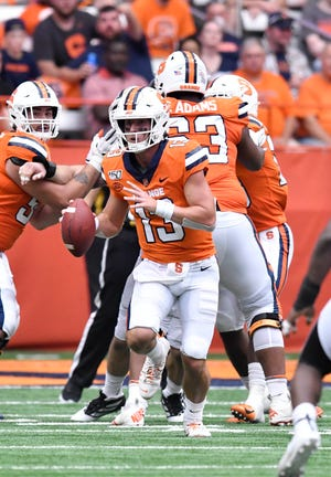 Sep 21, 2019; Syracuse, NY, USA; Syracuse Orange quarterback Tommy DeVito (13) runs out of the pocket against the Western Michigan Broncos in the third quarter at the Carrier Dome. Mandatory Credit: Mark Konezny-USA TODAY Sports
