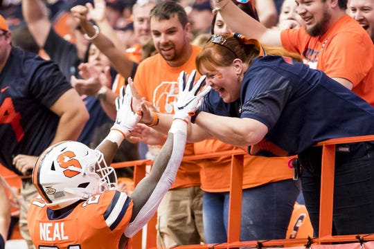 SYRACUSE, NY - SEPTEMBER 21:  Moe Neal #21 of the Syracuse Orange celebrates his touchdown carry with fans during the first quarter against the Western Michigan Broncos at the Carrier Dome on September 21, 2019 in Syracuse, New York.  (Photo by Brett Carlsen/Getty Images)